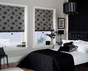black flowery roman blinds