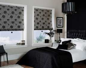 black flowery roman blinds
